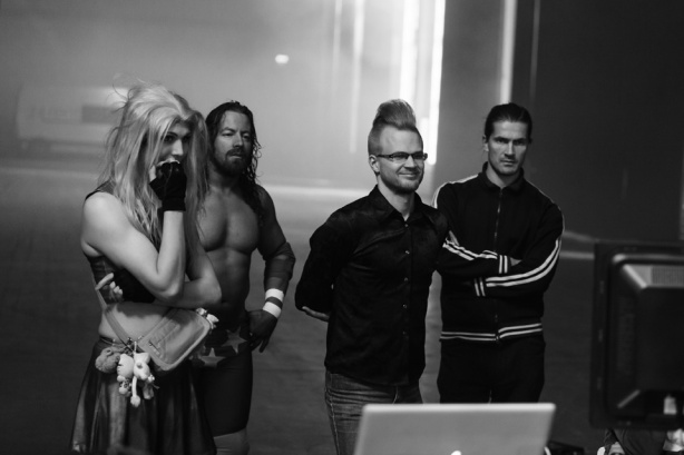 My movie rival, transsexual wrestler Jessica Love, looks on at the filmed segments between takes with writer ilja Rautsi and director Oskari Pastila.