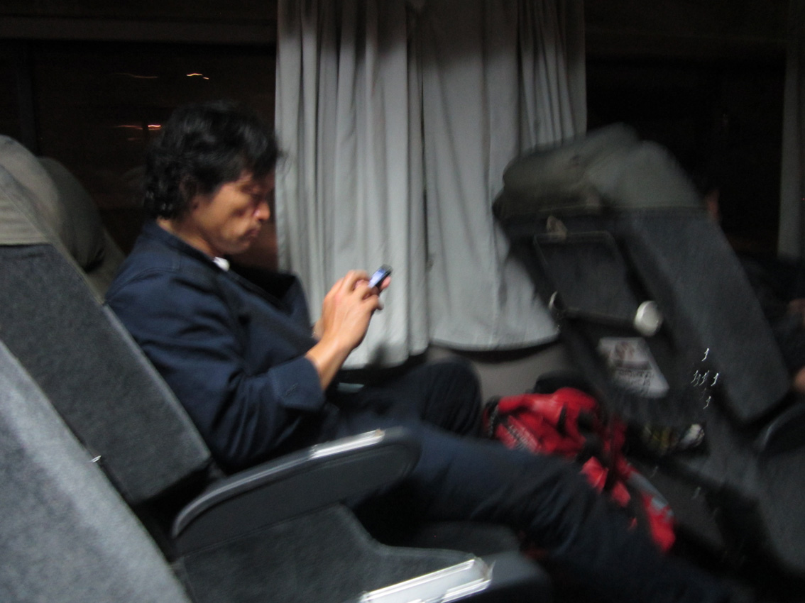 On the WNC tour bus, AKIRA awaits arrival in Osaka, where we have our next match.