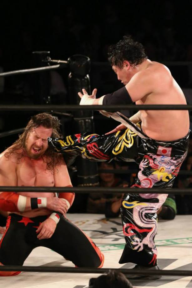 Tajiri kicks awat at me (photo by Yuichi Kojima)