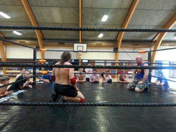 Showing the ropes to the students with top Danish wrestler Chaos